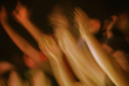 exaltation: Hands raised at a concert Stock Photo