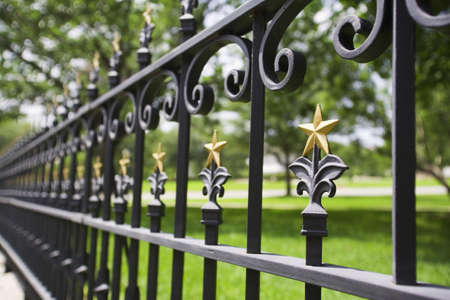 raniszewski: Fence with gold stars Stock Photo