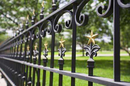 raniszewski: Fence with gold stars Stock Photo