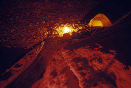 pinchbeck: Campsite and kayak at night