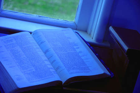 the scriptures: Open Bible at window side
