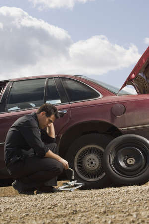 inconvenience: Tire frustrations at roadside Stock Photo