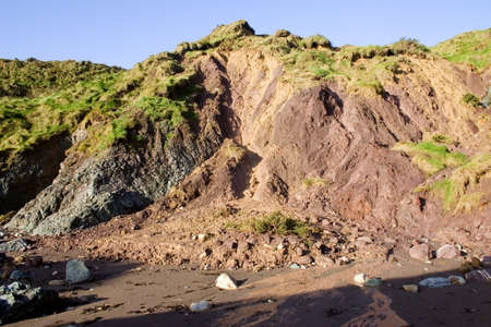 forbids: Cliff Erosion, Ballydowane Cove, Copper Coast, Co Waterford, Ireland Stock Photo