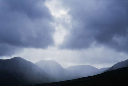 bens: Rain over the Twelve Bens, Connemara, Ireland Stock Photo