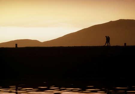 sepias: People walking along a quay, Ireland