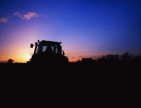 ploughing: Tractor Ploughing Stock Photo