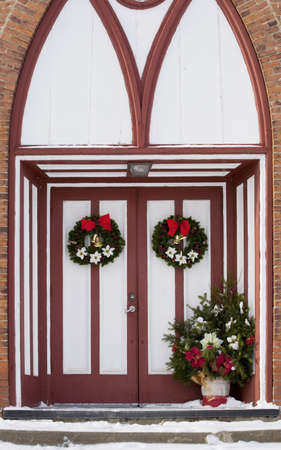 Church doors adorned with Christmas decorations photo