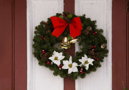 Christmas wreath hanging on a door photo