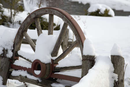 weather beaten: Wooden carriage covered in snow Stock Photo