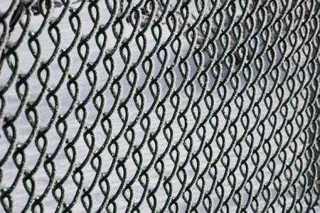 metal textures: Chain link fence covered in frost