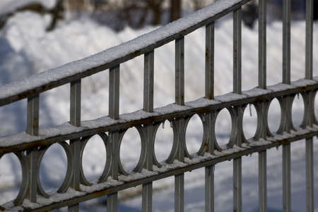 Gate covered in snow