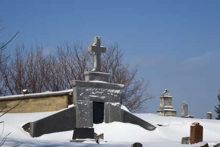 Gravestones in a cemetery covered in snow Stock Photo - 7268338