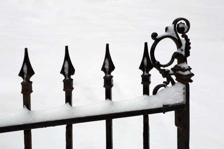 Iron gate covered in snow