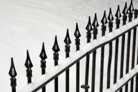 iron gate: Iron gate covered in snow