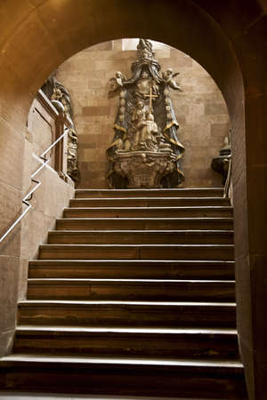 religious building: Strasbourg, France; Cathedral steps leading up to a statue