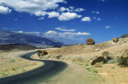 curve road: Death Valley, California, USA; Winding road in front of expansive desert
