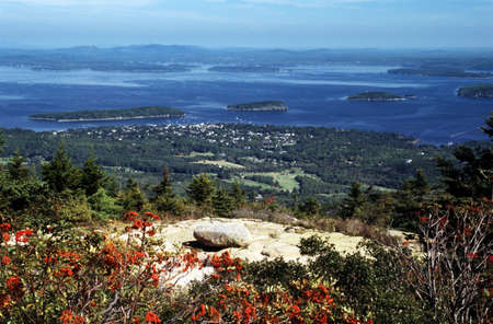 maine: Acadia National Park, Maine, USA; Cadillac Mountain overlooking a coastal town Stock Photo