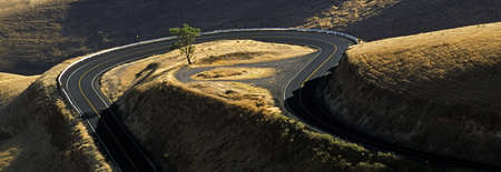 arial views: Idaho, USA; Road winding around hilly landscape Stock Photo
