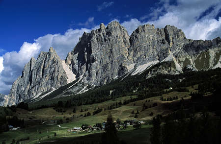 towering: Italy; Rock formations towering over houses Stock Photo