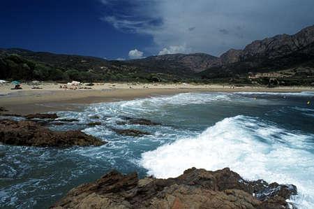 Corsica, France; People enjoying the sun on a Mediterranean beach photo