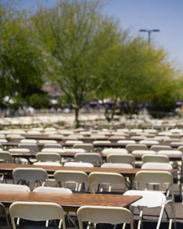 Large amount of empty chairs and tables sitting outside Stok Fotoğraf