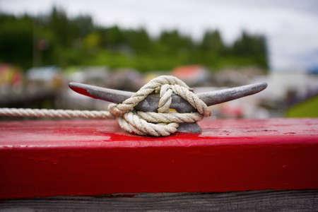 raniszewski: Rope tied to dock cleat Stock Photo