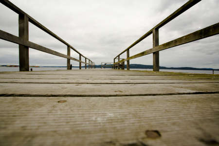 raniszewski: British Columbia, Canada; Surface level view of wooden dock, with a view into land Stock Photo