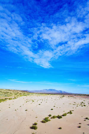 raniszewski: New Mexico, USA; Expansive desert with the Sierra Ladrones mountains in the distance Stock Photo