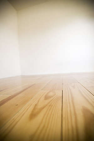 Empty room with wooden floors and white walls Stock Photo - 7183783