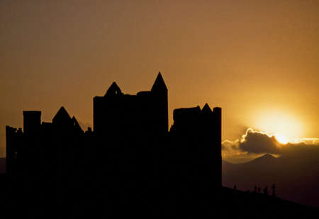 Cashel Rock,Co Tipperary,Ireland;Cashel Rock silhouetted against majestic sunset Stock Photo