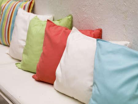 throw cushion: Pillows on a bench, Mykonos, Greece Stock Photo