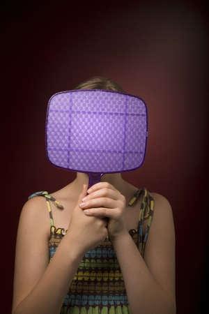 pre adolescent child: Girl with a mirror Stock Photo