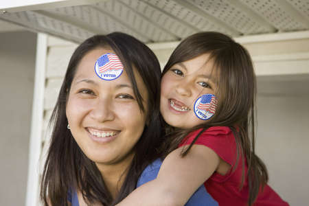 voted: Portrait of mother and daughter