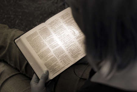 high angles: Woman reading the Bible Stock Photo