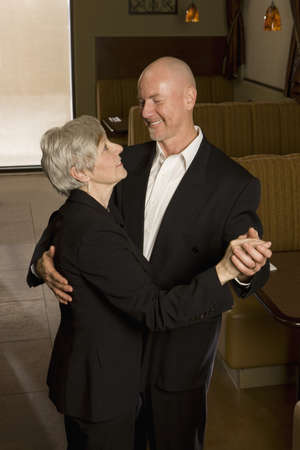 Senior couple dancing photo