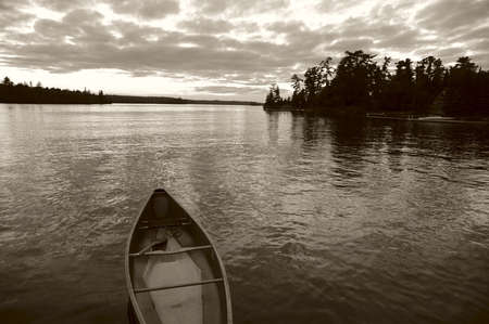 sepias: Lake of the Woods, Ontario, Canada; Boat on the water