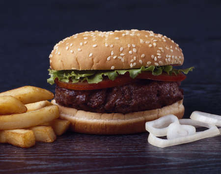 beefburger: Beefburger,chips and onions Stock Photo