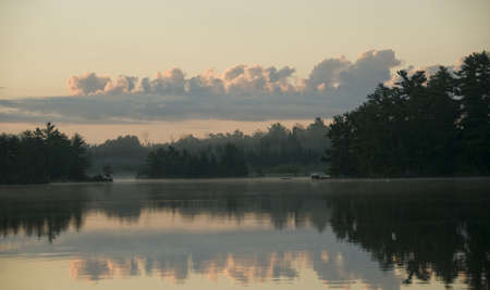 Lake of the Woods, Ontario, Canada; View across lake at sunrise Stock Photo - 7192244