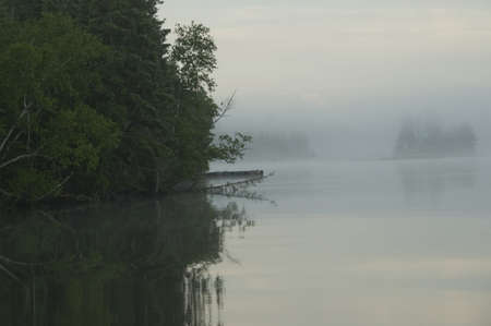 Lake of the Woods, Ontario, Canada; View across lake at sunrise photo