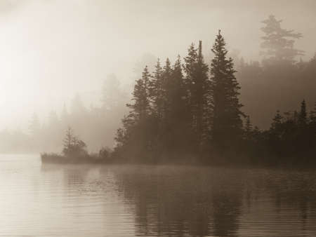 Lake of the Woods, Ontario, Canada; Mist rises over lake photo