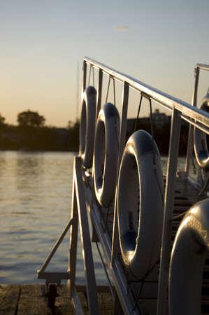 gangway: Kenora, Lake of the Woods, Ontario, Canada; Life preservers hanging on a dockside gangway