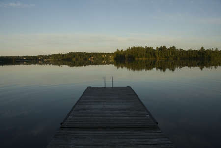 Lake of the Woods, Onta, Canada; Pier looking out over lake toward forest Stock Photo - 7191142