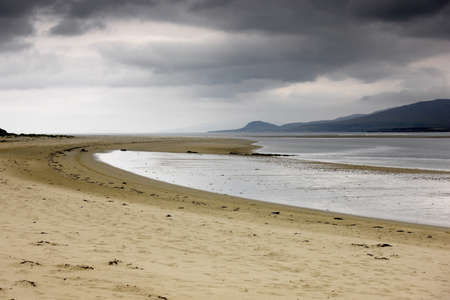 stormy waters: Islay, Scotland; Storm clouds by a beach