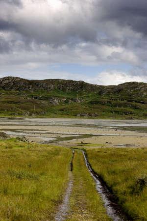 Islay, Scotland; Tire tracks down to a beach Stock Photo - 7205494