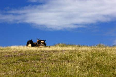 Islay, Scotland; Tractor in a field Stock Photo - 7196541