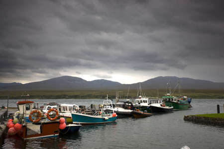 Islay, Scotland; Row of boats at a jetty Stock Photo - 7196692