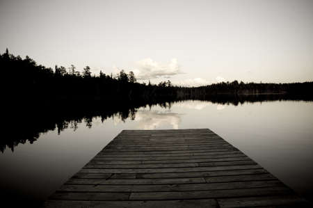 black and white photography: Lake of the Woods, Ontario, Canada; Pier looking out over lake