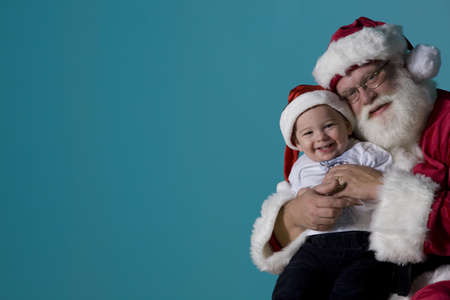 Portrait of Santa with a baby Stock Photo