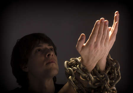 hand chain: Man in chains Stock Photo