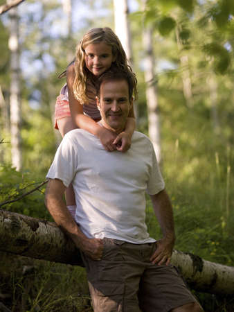 caucasian ancestry: Daughter embracing father, Lake of the Woods, Ontario, Canada